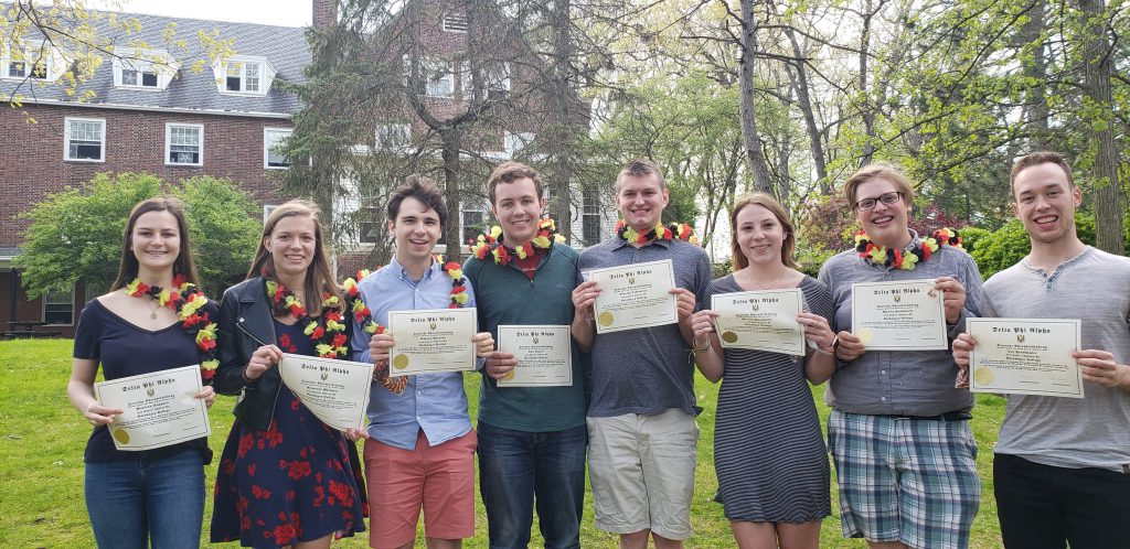 Student Honors Society members with certificates from annual Maifest celebration