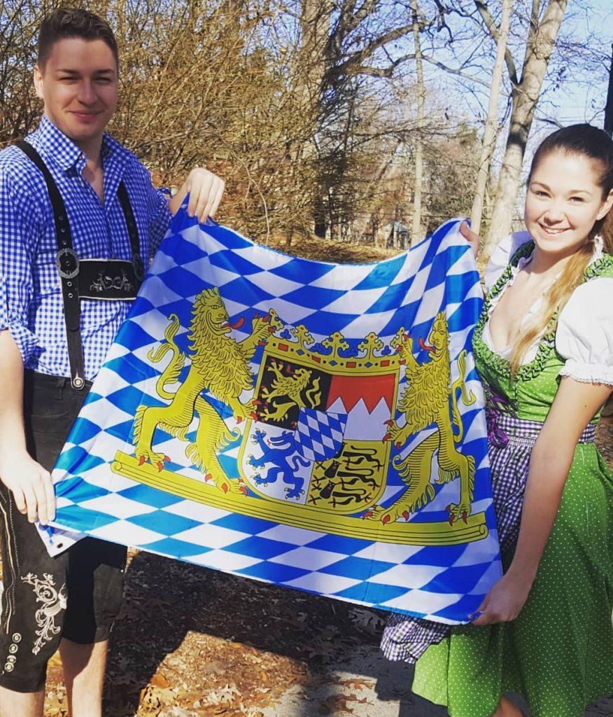 two students with Bavarian flag