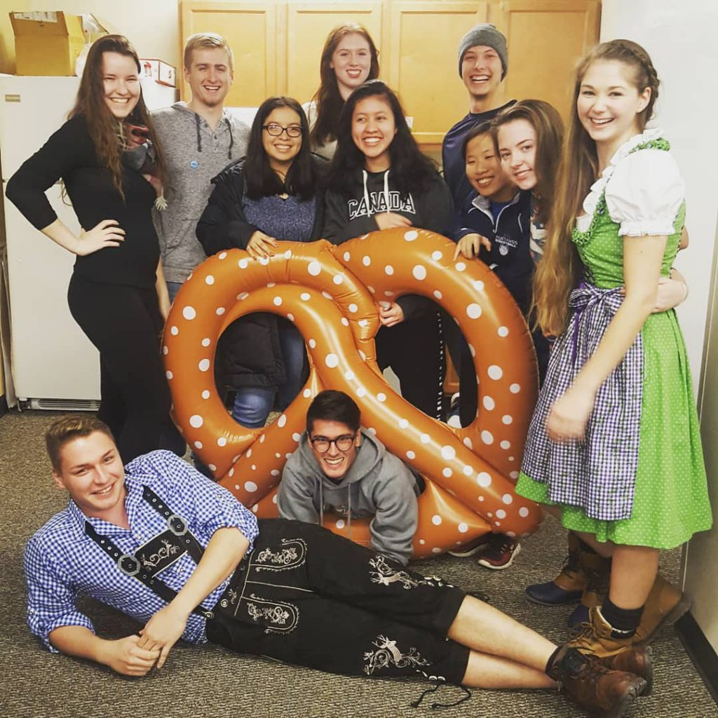 group of students with giant pretzel
