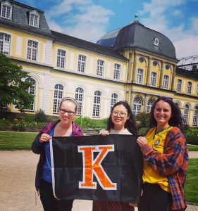 students on study abroad holding K flag