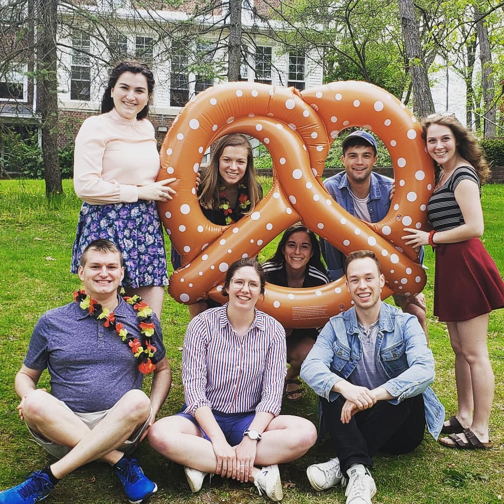 German students out on campus with a giant pretzel