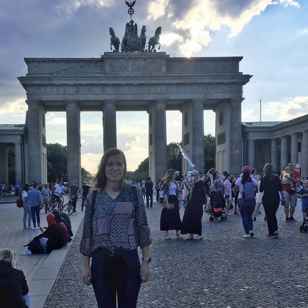 student in Berlin in front of Brandenburg Gate